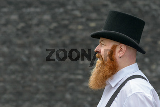 Side view of a bearded man in retro style fashion