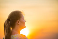 Woman looking to beautiful sunset