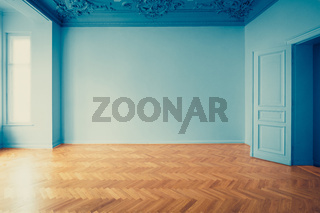 empty room historic old building restoration - interior  renovation concept, vintage look apartment room with parquet floor and stucco ceiling -