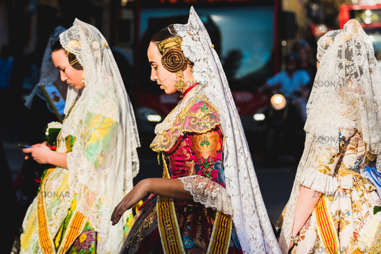 Valencia, Spain - March 17, 2019:  Women wearing the traditional dress in Fallas, parading through the streets of the city on the day of the offering to the Virgin.