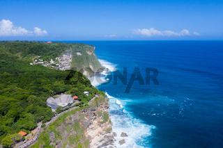 beautiful uluwatu cliff with blue sea in bali island