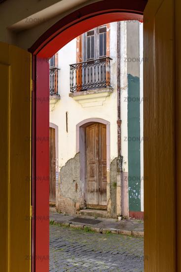 Door and balcony viewed through another door