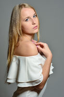 beautiful blonde woman with long blowing hair with natural make-up.