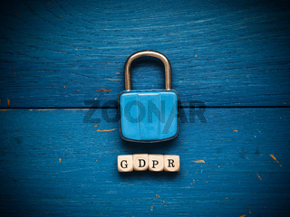 GDPR concept image on rustic blue wood