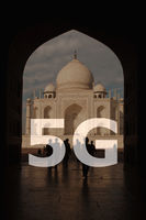 5G text on Taj Mahal India background.