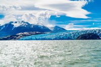 View of the majestic blue ice of Glacier Grey on the water of Lake Grey in Torres del Paine National