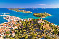 Dalmatian town of Tribunj church on hill and amazing turquoise archipelago aerial view