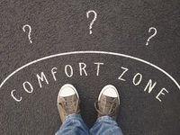feet of unrecognizable person standing inside comfort zone