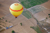 Air balloon flying over the land
