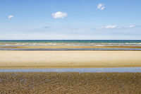 Minimalistic layered seascape with yellow, green and blue blue