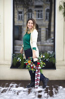 Happy woman holding Christmas wreath