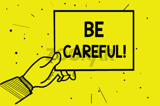 Word writing text Be Careful. Business concept for making sure of avoiding potential danger mishap or harm Man hand holding paper communicating information dotted yellow background.