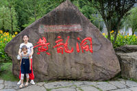 Children in front of stone with chinese characters