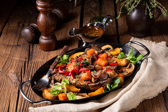 tender beef topped with various vegetables