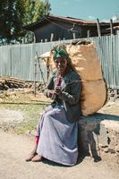 Ethiopian woman resting with sack of charcoal, Ethiopia