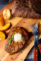 Butter Beef Steak with herbs and potato wedges
