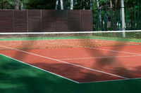 Large summer tennis court in the Park.