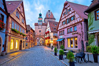 Cobbled street of historic town of Rothenburg ob der Tauber dawn view