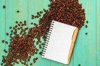 Coffee beans with open notebook for notes
