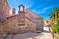 Blato on Korcula island historic stone square and church view
