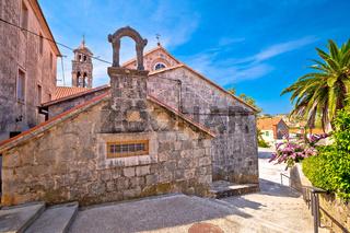 Blato on Korcula island historic stone square and church view