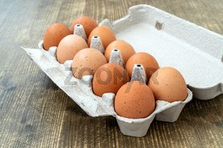 Raw chicken eggs in egg box