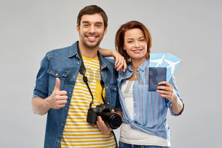 happy couple with air tickets, passport and camera