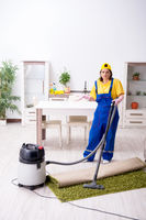 Old female contractor doing housework