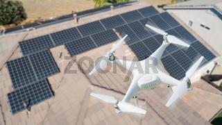 UAV Drone Inspecting Solar Panels On Large House