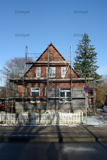 small house with scaffolding