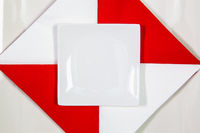 Ceramic square bowls for sushi food with red and white napkins.