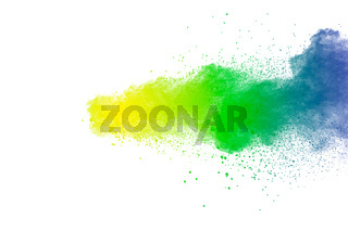 Colorful powder explosion on white background.Abstract blue yellow green  color dust particles splash.