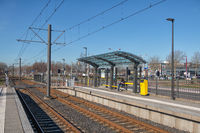 Tram station with with waiting woman in Nieuwegein, the Netherlands