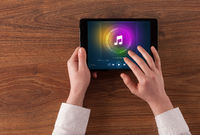 Hand holding tablet with music play concept