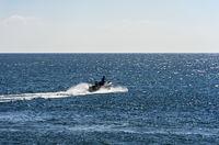 Motorboat on the open sea, near Tavira, Algarve, Portugal