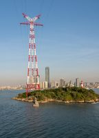Tall electricity pylon in harbor of Xiamen China