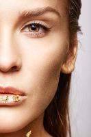 Closeup macro beauty portrait of young woman face