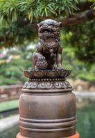 Lion wiht paw on globe in Chi Lin Nunnery