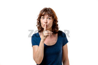 Middle-aged woman making a shushing gesture