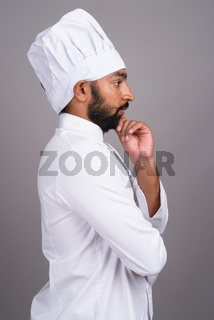 Profile view of young Indian man chef thinking
