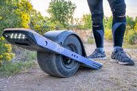 onewheel electric skateboard on a dirt trail