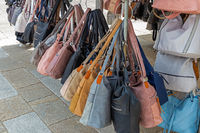 Handbags for sale at a market stall in Germany