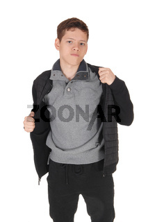 Young handsome teen boy in a gray jacket