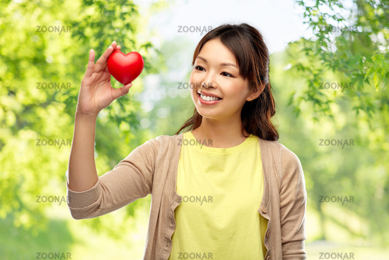asian woman with red heart over natural background