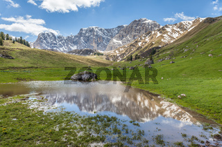 Small mountain lake at on the Seiser Alm