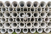 Stack of concrete sewer pipes at dutch factory