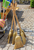 Brooms for sale at a market stall in Germany