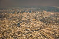 downtown los angeles skyline and suburbs from airplane and smoke from wild fires