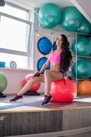 Fitness. Cute woman posing during workout at gym