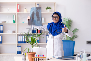 Female doctor in hijab working in the hospital